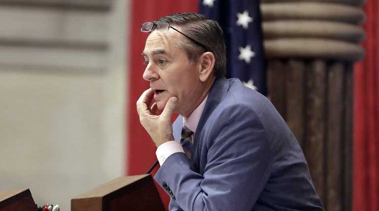 House Speaker Glen Casada, R-Franklin, stands at the microphone during a House session in Nashville, Tennessee