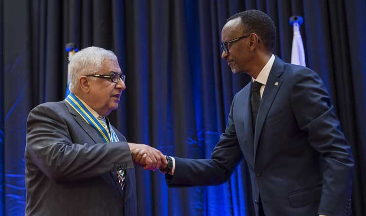 President Kagame congratulating Gilbert R. Chagoury upon bestowing him with the Igihango medal.