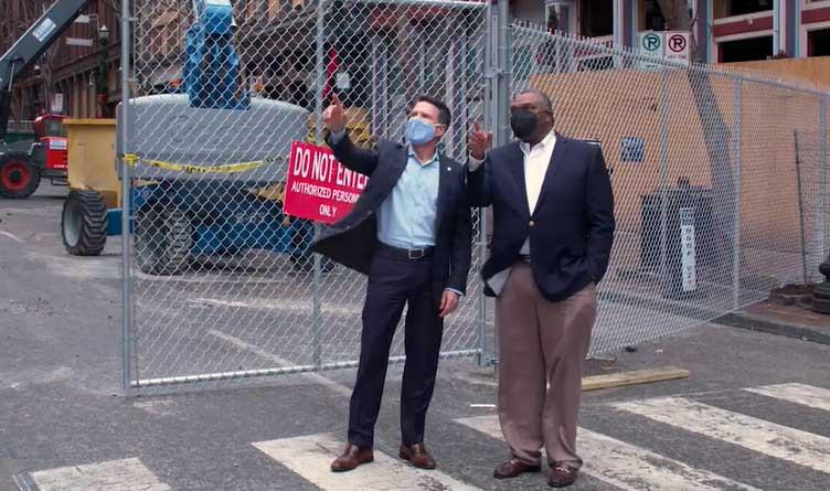 Dan Pratt of TVA and Decosta Jenkins of NES assess bombing damage in Nashville, TN