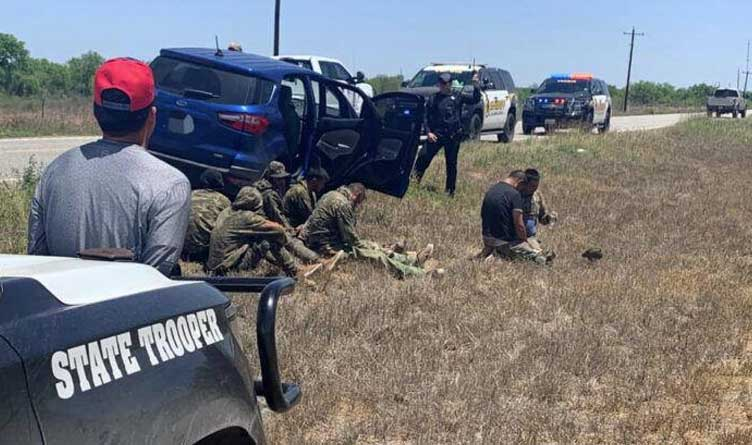 Seven immigrants and an alleged human trafficker apprehended in La Salle County, Texas, April 24, 2021.