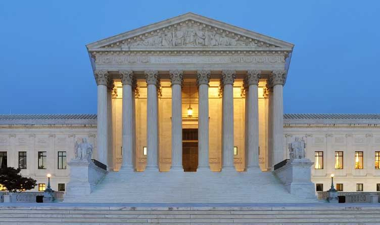 west facade of United States Supreme Court Building at dusk in Washington, D.C., USA