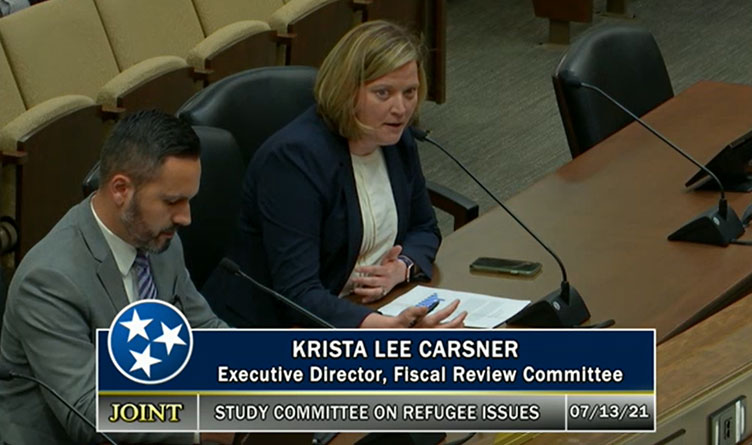 Krista Lee Carsner, executive director of the Tennessee General Assembly's Fiscal Review Committee, presents her cost estimate research to the state's Study Committee on Refugee Issues