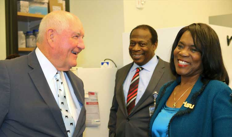 Sonny Perdue (left) enjoys a light-hearted moment with TSU President Glenda Glover and Dr. Curtis Johnson