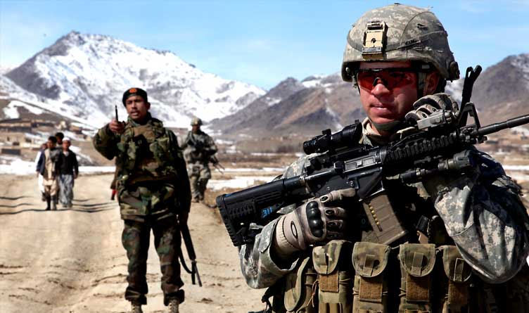 U.S. Army Soldier patrols with Afghan soldiers to check on conditions in the village of Yawez in Wardak province, Afghanistan.